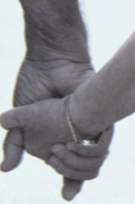 My dad and my bonus mother holding hands in April 2010 just after they married.
