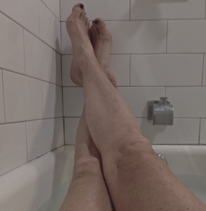 this isn't the bathtub in the yellow house but those are my gangly legs.